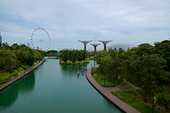Gardens by the Bay with Lake, Flower Dome, Super Trees and Singapore Flyer (UweBKK (α 77 on )) Tags: singapore southeast asia city state island urban sony alpha 77 slt dslr gardensbythebay garden bay lake super trees supertrees flower dome water reflections sky clouds