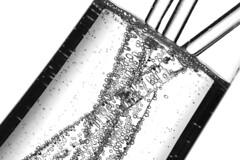Fizz (Karen_Chappell) Tags: bw bubbles fizz glass white blackandwhite swizzlestick abstract tilt lines liquid fizzy bubbly stilllife