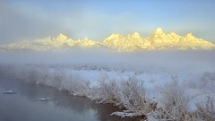 Floating on a Sea of Steam (Kevin Benedict Photography) Tags: grandteton nationalpark sunrise light morning alpenglow landscape stream mountains nikon winter tetons grosventre photobenedict kelly wamspring hotspring steam fog ice beautiful snow scenery longexposure