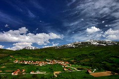 The Village (azem) Tags: blue sky mountains clouds canon landscape eos spring bravo village 2006 azem kosova sharri thesource opoja zaplluxhe specnature impressedbeauty qemdadminfave
