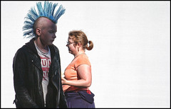 Two cultures.....[version two] (shadowplay) Tags: bumbershoot musicfestival seattle hair mohawk its about light