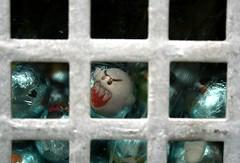 Bad Guy Behind Bars (raumoberbayern) Tags: blue topv111 silver munich mnchen toys dispenser topv555 topv333 findleastinteresting topv444 fv5 topv222 photodomino fv10 chewinggum grr muenchen robbbilder urbanfragments kaugummiautomaten kaugummi topf5 gumdome