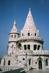 Fisherman's Bastion Tower (richardr) Tags: old city blue urban white building tower castle heritage history architecture geotagged europe hungary european gothic budapest 19thcentury historic magyar bastion ungarn turret europeanunion buda castlehill hungaria hungarian nineteenthcentury magyarorszg centraleurope gellerthill fishermansbastion hongrie historicalplaces varhegy geo:lat=4750291 geo:lon=19034543