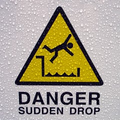 Sudden Drop (bartmaguire) Tags: danger raindrops sign yellow