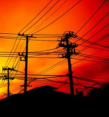 Wires at dawn (englishaugust) Tags: sunrise dawn city sky colour canon blog art travel urban light red wires silhouette 15fav wow 510fav street orange black crimson 1025fav pallette topf25 bigcalm 500v50f