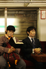 Private moments (Lil [Kristen Elsby]) Tags: man japan train subway japanese reading tokyo topf50 asia metro transport trainstation transportation transit commute  publictransport topv3333 salaryman omotesando chiyodaline eastasia