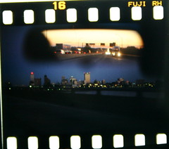 Day divides the night (Gary Bridgman) Tags: bridge skyline river mississippi downtown dusk memphis arkansas lonelyplanet fromthecar i40 snowcrash yabusame westmemphis bridgman hernandodesoto universityofmemphis pikappaphi japanesearchery bridgeman horsebackarchery arkansasbeauty mountedarchery