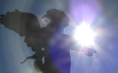 an angel's power (raspberrytart) Tags: sun cemetery grave statue angel canon wow albaluminis lovely1 headstone loveit flare powershota70