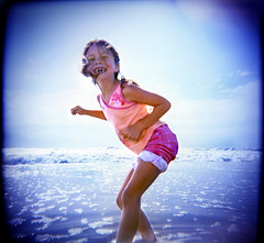 Gotcha! ([ CK ]) Tags: sky beach topf25 water girl smile wow happy holga interestingness interesting topv333 toycamera young playful plasticcamera skypeople