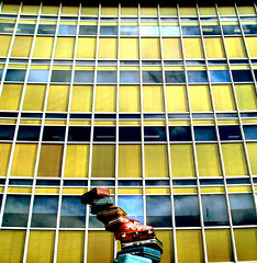 snakes & ladders (macca) Tags: snakesandladders suitcase bags stacked pile building windows squares glass reflection grid artnabout sydney australia