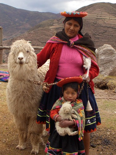 typical Peruvian woman with child and llama for post about maca