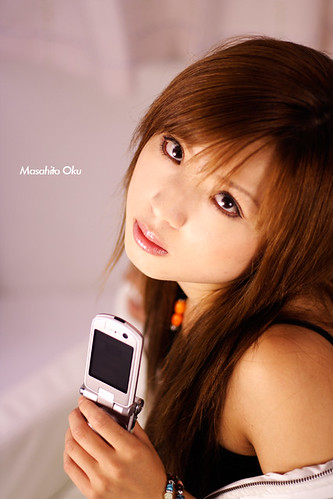 Sexy Young Girl Model for Advertising photograph of mobile phone