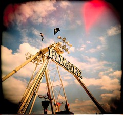 pirates! 2 (WadeB) Tags: holga xpro crossprocess fair pirate sky cloud ride film 2005 square toy blue epl120ektachrome400x 1025fav toycamera