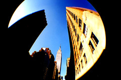 The Price of Gas (lomojunkie71) Tags: city nyc newyork lomography manhattan fisheye empirestatebuilding notcrossprocessed