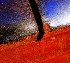 The Gap (Mr. Greenjeans) Tags: old railroad blue red abstract macro art topf25 closeup contrast manipulated catchycolors interestingness rust decay steel object topv444 tracks gap picasa 100v10f explore part squareformat mostinteresting connection deterioration 500x500 1000v40f