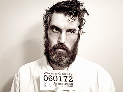 Straight ahead - Mugshot (wiseacre photo) Tags: portrait beard profile whiskerino bum prison criminal crime jail mugshot wiseacre convict beaten hobo bruised day93 paularmstrong