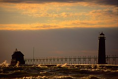 Sunset and Waves (Mrs. Terry) Tags: architecture clouds mi reflections lighthouses sunsets lakemichigan lanterns grandriver catwalk naturesfinest grandhavenmi natureslight instantfave innerlighthouse blanketofclouds flickrific outerlighthouse photosbyterry copyright2007byteresamforrest