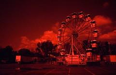 Expo Wheel, Jennings Beach Carnival (Alexander Rabb) Tags: carnival film beach canon fuji connecticut ct fair ferriswheel amusementpark konica fairfield fujisuperia800 konicahexarrf c41 redscale expowheel jenningsbeach canonserenar28mmf35 jenningsbeachcarnival