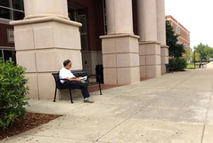 Man on Bench Outside of Library