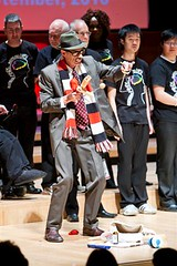 Roving performer with With One Voice choir