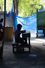 Haitian school boy taking exams. (Jesonis|Photography_On/Off (super busy)) Tags: haiti grandgoave caribbean canondslr canon35mmf14l haitianschool education school exams haitianstudent