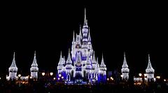 castle at night during Christmas (Turnstiles gone by) Tags: disney disneyworld magic kingdom magickingdom park christmas castle florida light fireworks night nighttime