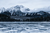 The Patricia and The Pyramid (Quincey Deters) Tags: allrightsreserved â©quinceydeters canada nature outdoor 2015 january colourimage horizontal landscape lake water ice snow mountain tree forest northamerica alberta jaspernationalpark jasper rockymountains canadianrockymountains pyramidmountain patricialake aspentree pinetree winter morning overcast cloudy