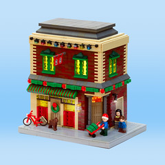 Winter Village: Corner Store (Carson Hart) Tags: lego corner store modular building christmas hannukah holiday holidays wreath santa hat bike window technique style light decorations plants plant minifigure minifigures dog animal door brick wall holly flower carson hart photography photo edit editing new year snow happy