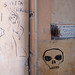 Death themed Rome back alley art