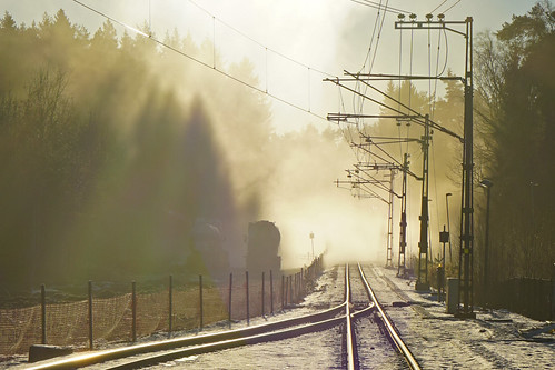 Sunny mist over the tracks in December