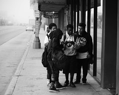 (Casey Lombardo) Tags: longbeach longbeachca streetphotography streets kids youth friends friendship bw bwphotography blackandwhite monochrome monochromatic bwstreetphotography signs fabric sidewalk