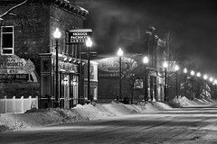 after midnight / wind (twurdemann) Tags: aftermidnight architecture blackandwhite building canada city cold downtown empty fujixt1 night niksilverefex northernontario ontario queenstreet saultstemarie skeggspaciocco snow streetlights urban wind winter xf55200mm