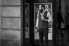 The Model Gentleman (Leanne Boulton) Tags: monochrome urban street candid portrait portraiture profile streetphotography candidstreetphotography candidportrait streetlife handsome man male pretty face facial expression beard waistcoat beauty smoke smoker smoking cigarette coffee window reflections tone texture detail depth composition natural outdoor light shade city scene human life living humanity society culture people fashion style stylish canon 5d 5dmarkiii 70mm character hipster ef2470mmf28liiusm black white blackwhite bw mono blackandwhite glasgow scotland uk