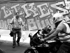 Wait For Me! / Esperadme! (mediterraneobcn) Tags: barcelona street city travel people espaa man bike writing bag beard graffiti blackwhite calle spain gate europa europe locals exterior ride gente grafiti outdoor walk text bcn helmet july ciudad catalonia personas motorbike viajes julio rush moto vehicle caminar bolsa casco hombre barba catalua bolso openair raval texto motocicleta andar blanconegro conducir escritura airelibre prisa callejera 2015 montar vehculo motorbicycle lugareos barcelonaexperience mediterraneobcn domingocalvo