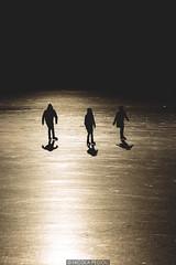Skating on gold (Nicola Pezzoli) Tags: lago endine lake ice winter cold bergamo lombardia italy tourism colors monasterolo gold sunset sun reflections silhouette skating