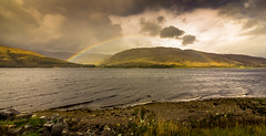 Colour has the power to influence the soul. (Ian Emerson) Tags: rainbow water loch stormy rain sunlight clouds hills mountains landscape light sky outdoor 1018mm canon wideangle scotland glencoe omot