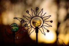 Let There Be Light... (oliemackeral) Tags: garden metal glass art sun moon sunset trees bokeh nature yardornaments gold handmade