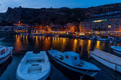 Behramkale Assos ,Turkey - January 01, 2017 : sunset at ancient harbour with hotels and fishing boats (yuliakupeli) Tags: greece acropolis aegean ancient archeology architecture assos athena behramkale blue boat building cafe canakkale civilization classical cloud culture day europe famous fishing golden greek harbor historical history hotel house iskele landmark landscape marble mediterranean monument old outdoors past place port roman ruined ruins scene sea sky stone summer sunset temple tourism traditional travel turkey vacation village wall water