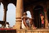 Temple Scene - Maheshwar, India (Maciej Dakowicz) Tags: asia india maheshwar city people temple dog dailylife