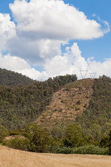 over the hill and faraway (eanwe) Tags: brindabella cloud landscape sky tree trees wire