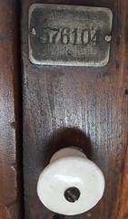 FIVE SEVEN SIXTY-ONE O FOUR (akahawkeyefan) Tags: wood cabinet plate metal tag davemeyer kingsburg knob white