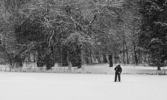 Man with an icedrill // Rianás (.mec) Tags: drilling drill d90 crack snowing ice hungary 85mm fishing black snow white man nikon texture tree cold street people winter forest frozen lake landscape