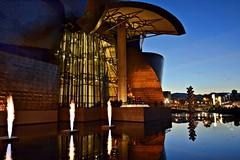 Guggenheim Bilbao (Aránzazu Vel) Tags: reflejos reflections atardecer sunset guggenheim museo bilbao museum bluehour basquecountry arquitectura architecture urban city ciudad