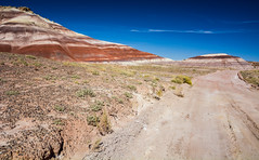 Painted Hills in Cathedral Valley, Capitol Reef National Park, Utah, USA (vonHabsburg) Tags: usa unitedstates vereinigtestaaten nature natur capitolreefnationalpark capitolreef paintedhills sky himmel road mud unpaved cathedralvalley utah landscape landschaft sand felsen rocks outdoor