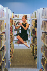 Leisurely Reading (Nate Conn) Tags: lara dance people model woman girl ballet pointe shoes dancer library books sky blue orange yellow black white brown hair young inside indoor ballerina legs floating levitating levitation jump jumping reading hovering flying