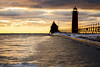 Grand Haven Golden Light (matthewkaz) Tags: silhouette pier lighthouse catwalk grandhavenlighthouse grandhaven lakemichigan lake greatlakes water ice snow winter sunset sky clouds michigan 2016 birds