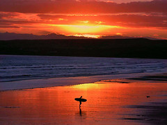 Sunset surfer (sue@serenityphotos) Tags: seascape surfer sunset ireland lahinch beach shore surf seaside sea water ocean sky orange coast clare