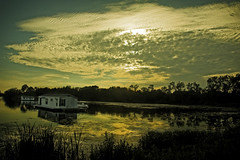 Houseboats (Gaby Swanson, Photographer) Tags: sunset nature reflections landscape colorful lakeerie sunsets presqueisle colorfulsunset palandscape