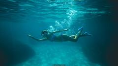 Underwater (Nicola Pezzoli) Tags: favignana sicilia sicily island egadi summer sea water colors nature canon tourism bubbles girl underwater blue