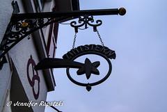 Zimtstern-Logo (Bernsteindrache7) Tags: winter sky sony alpha 100 city street stone düsseldorf germany heaven himmel nrw blue metal outdoor